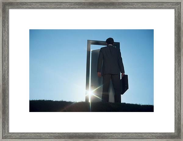 Businessman Entering Door Outdoors Framed Print by Comstock