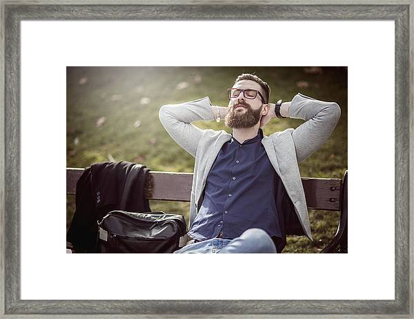 Businessman Relaxing On The Bench After Work Framed Print by DaniloAndjus