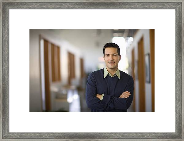 Businessman Standing In Hallway Of Office, Arms Crossed Framed Print by Siri Stafford