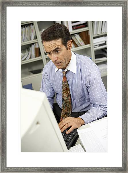 Businessman Working On Computer Framed Print by BananaStock