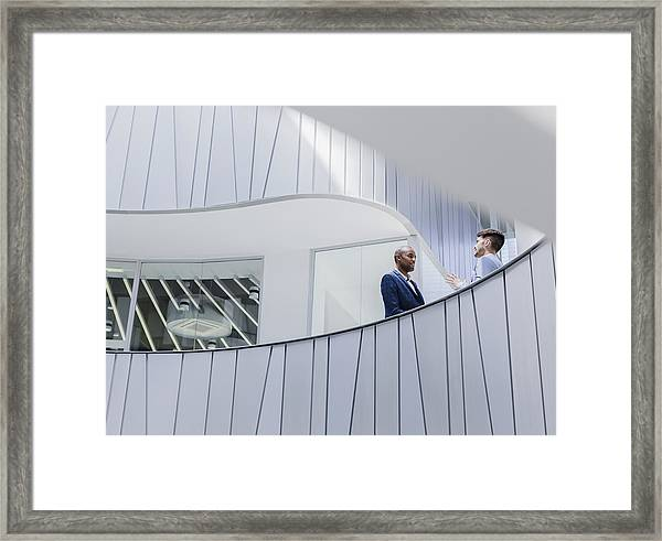 Businessmen Talking On Architectural, Modern Office Balcony Framed Print by Caiaimage/Martin Barraud