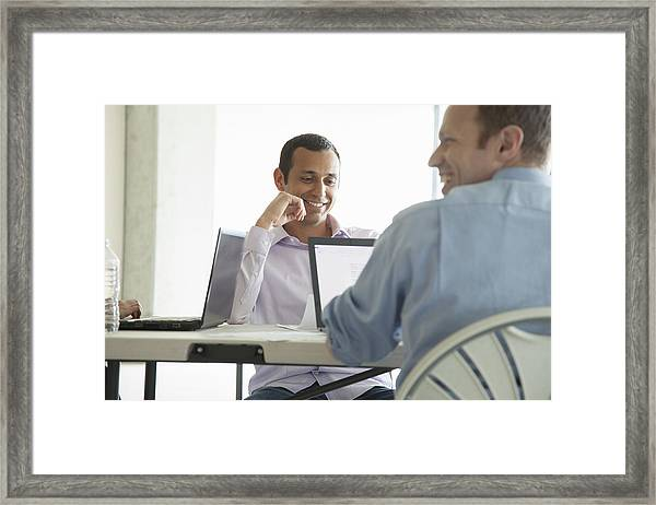 Businessmen Using Laptop Computers In Meeting Framed Print by Jetta Productions Inc