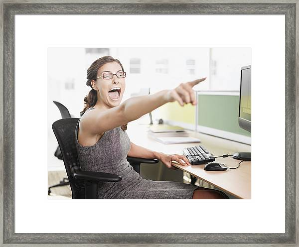 Businesswoman Pointing And Shouting Framed Print by Robert Daly
