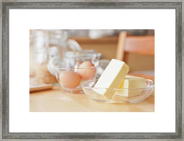 Butter And Eggs On Wooden Table Framed Print