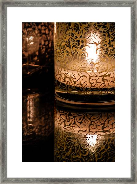 Candle Reflections Framed Print