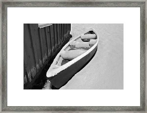 Canoe In The Snow Framed Print