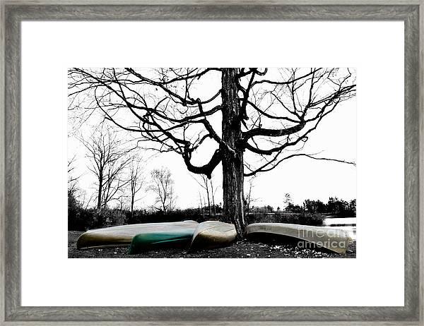 Canoes In Winter Framed Print