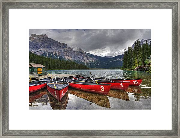 Canoes On Emerald Lake Framed Print