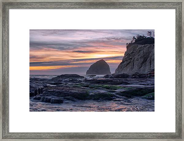 Cape Rocks And Surf Sunset Framed Print