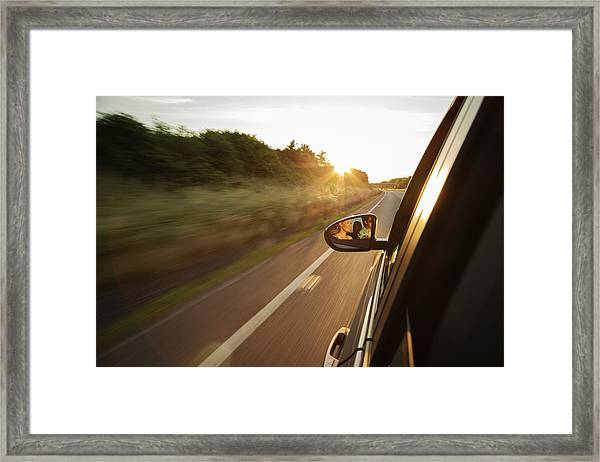 Car Driving Along Road, Reflection In Framed Print