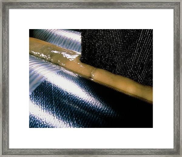Carbon Fibre Fabric Being Impregnated With Resin Framed Print by Tim Hazael/science Photo Library