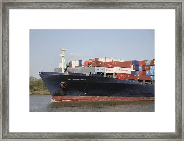 Cargo Ship On The River Framed Print by Bradford Martin