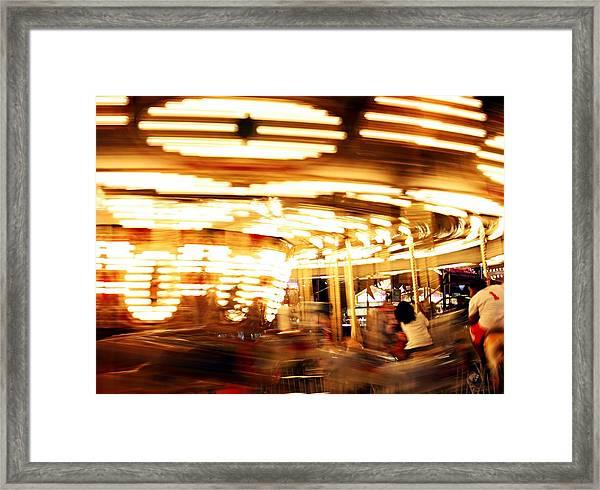 Carousel In Motion Framed Print