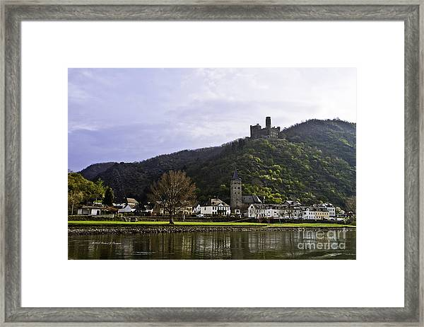Castle On Hill Above Town Framed Print