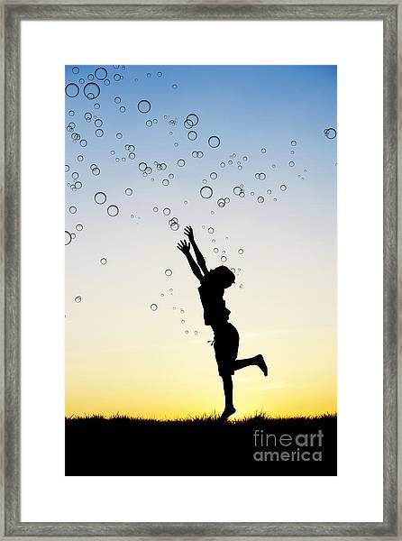 Catching Bubbles Framed Print