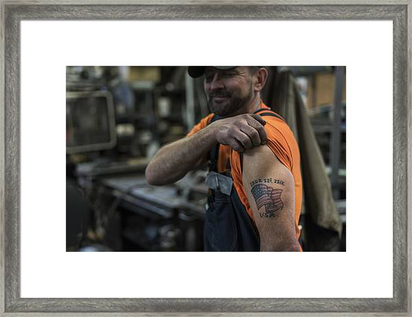 Caucasian Worker Displaying Tattoo In Factory Framed Print by Jetta Productions Inc