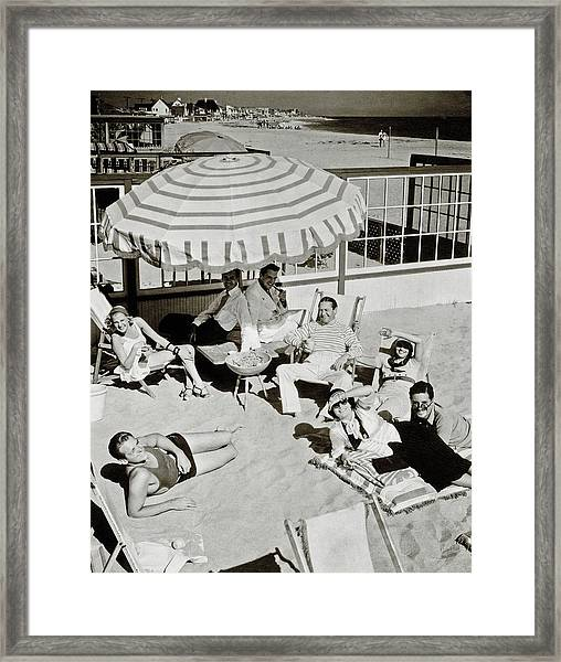 Celebrities On A Beach Framed Print