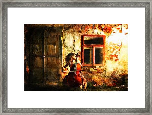 Cellist By Night Framed Print