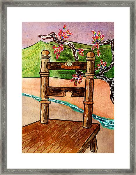 Chair In Landscape Framed Print