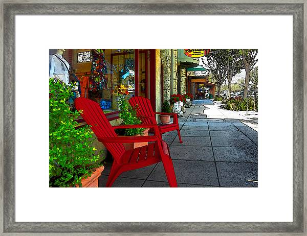 Chairs On A Sidewalk Framed Print