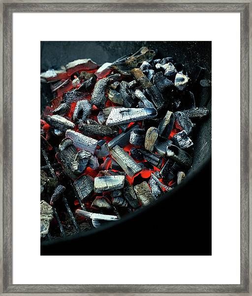 Charcoal On A Grill Framed Print