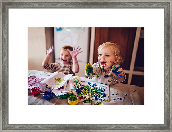 Cheerful Little Children Having Fun Doing Finger Painting Framed Print by Wundervisuals