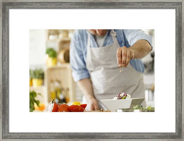 Chef Decorating A Plate With Healthy Salad Framed Print by Fotostorm