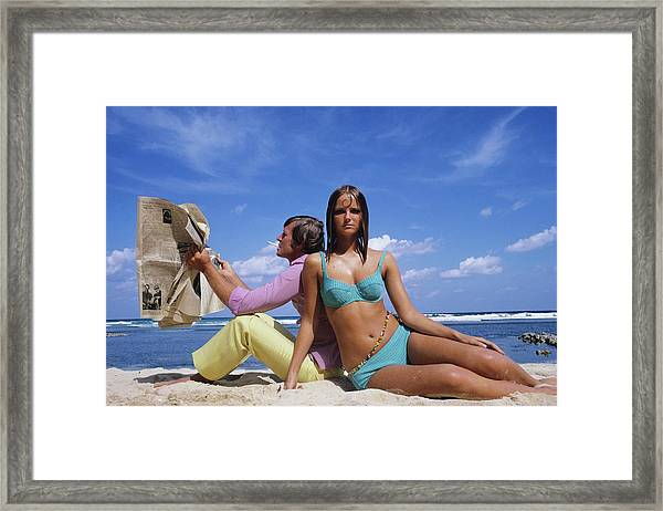 Cheryl Tiegs Modeling A Bikini At A Beach Framed Print