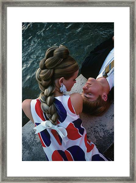 Cheryl Tiegs With A Male Model Framed Print