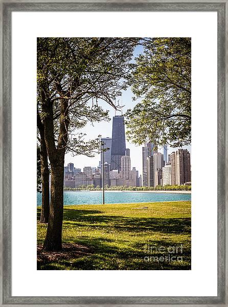 Chicago Skyline And Hancock Building Through Trees Framed Print