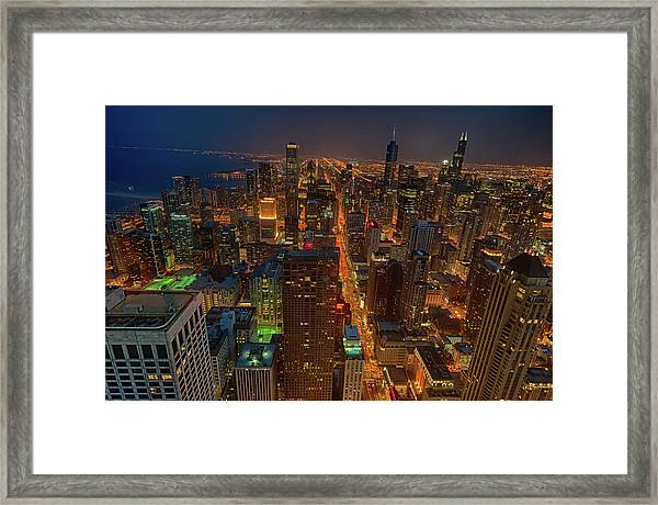Chicagos Magnificent Mile Framed Print by By Ken Ilio