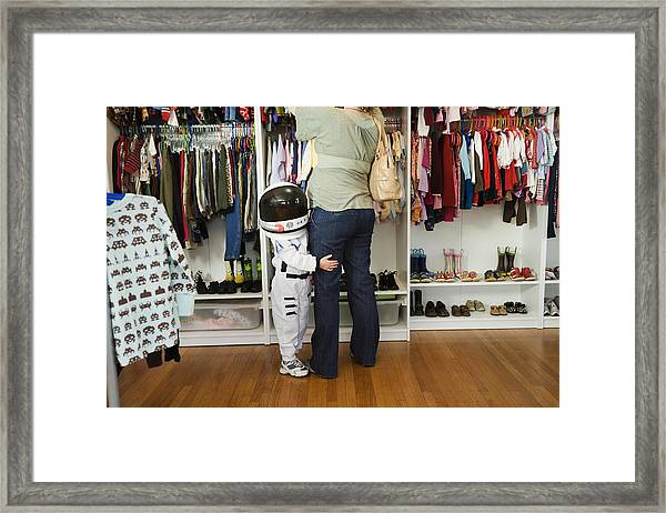 Child (4-5 Yeras) Wearing Space Costume Hugging Mother's Leg In Shop Framed Print by Inti St. Clair