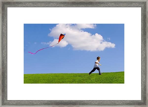 Child Flying A Kite Framed Print