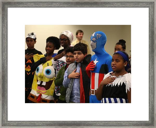 Children Attend Halloween-themed U.s. Citizenship Ceremony In Baltimore Framed Print by Mark Wilson