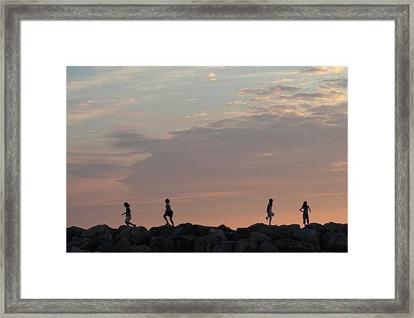 Children Paying At Sunset Time Framed Print by Carolyn Reinhart