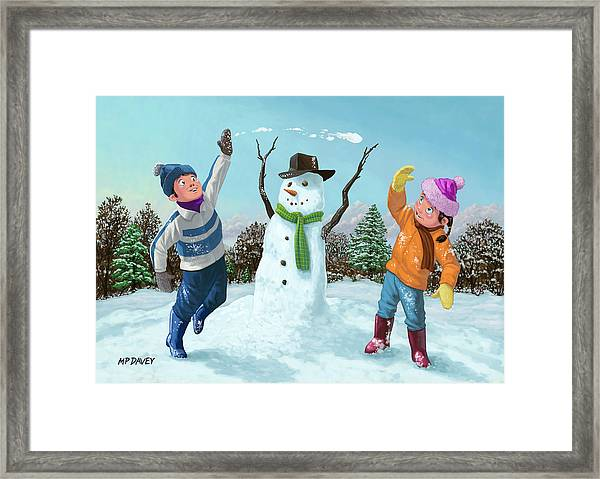 Children Playing In Snow Framed Print