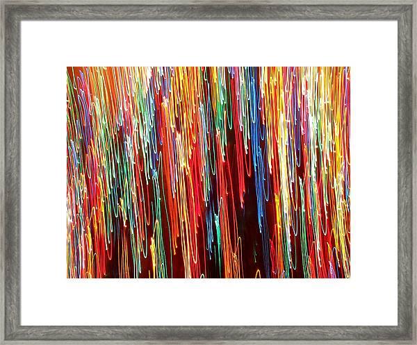 A Rainbow Melting  Framed Print