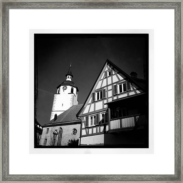 Church And Half-timbered House In Lovely Old Town Framed Print
