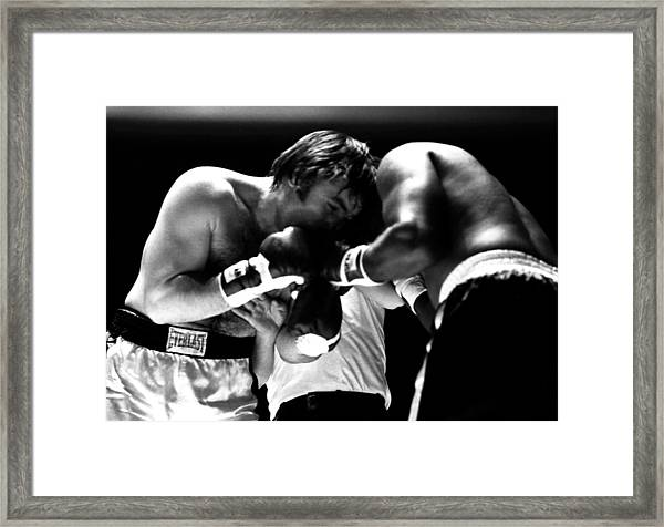 Chuvalo In A Clinch Framed Print by Robert  Rodvik