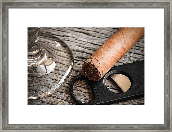 Cigar And Cutter With Glass Of Brandy Or Whiskey On Wooden Backg Framed Print