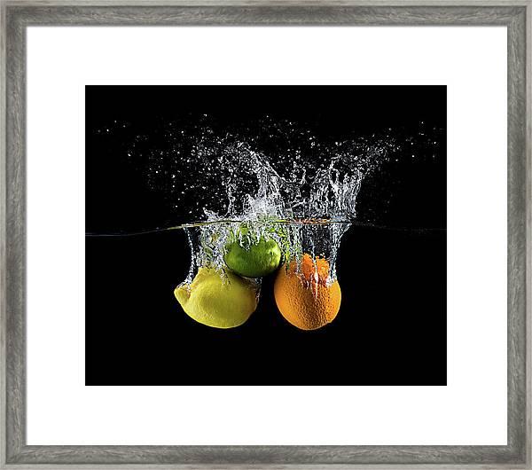Citrus Splash Framed Print by Mogyorosi Stefan