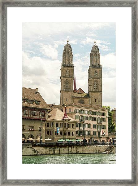 Cityscape With Grossmunster Church Framed Print