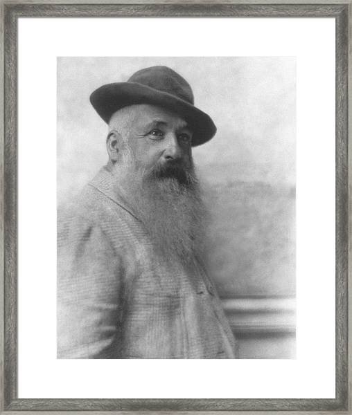Claude Monet Wearing A Hat Framed Print by Adolphe De Meyer