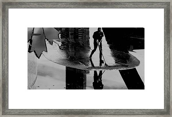 Cleaning The Sky Framed Print by Jian Wang
