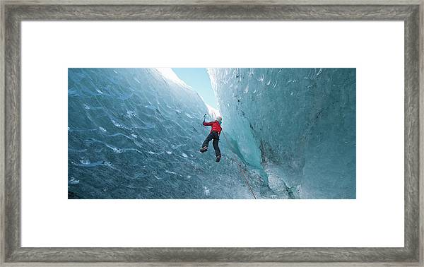 Climber Climbing Out Of Ice Cave Framed Print