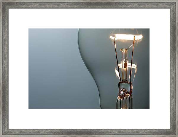Close Up Glowing Light Bulb Framed Print by Bernie_photo