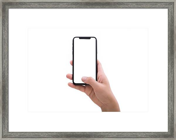 Close Up Hand Hold Phone Isolated On White Framed Print by Issarawat Tattong