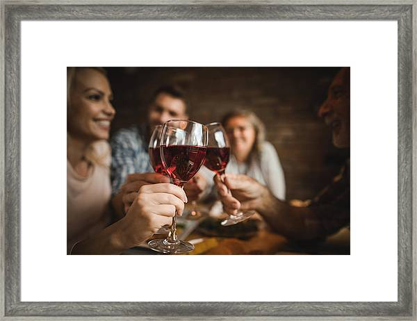 Close Up Of A Family Toasting With Red Wine At Home. Framed Print by Skynesher