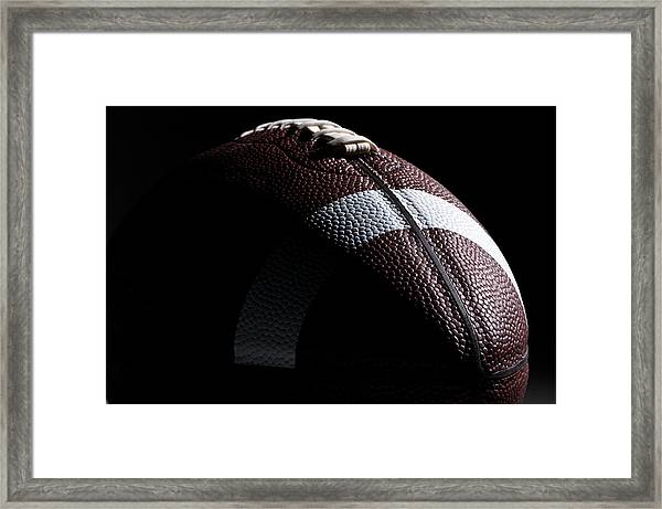 Close-up Of American Football With Dramatic Lighting Framed Print by Kledge