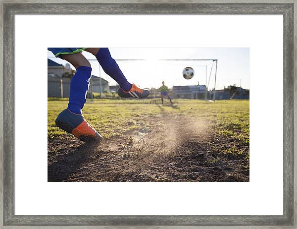 Close Up Of Boy Taking Soccer Penalty Framed Print by Alistair Berg
